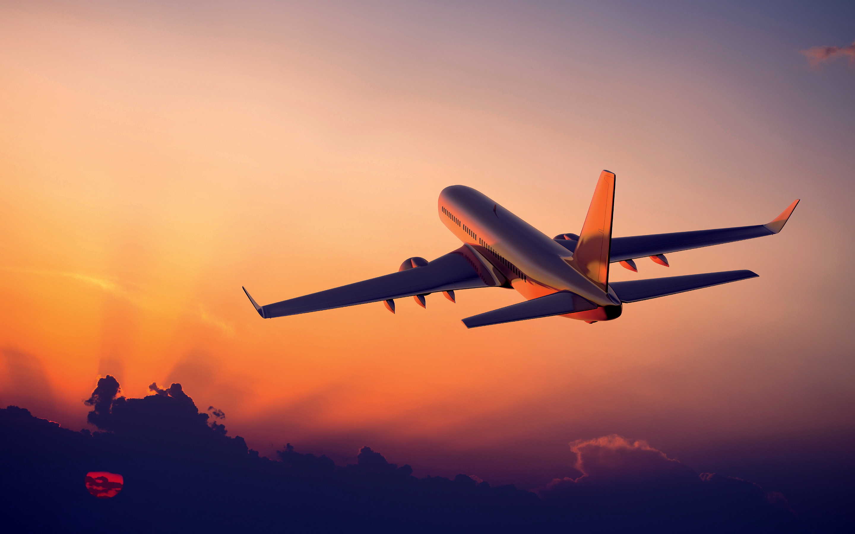 Airplane flight sunset ...