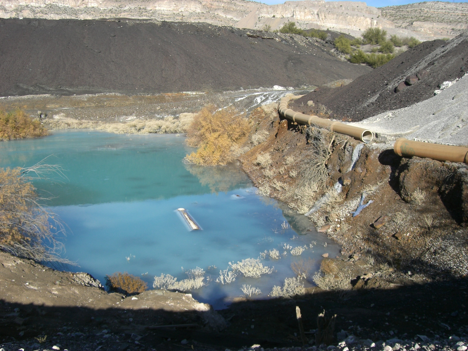 Hayden, Az: Asarco waste pond with broken pipe