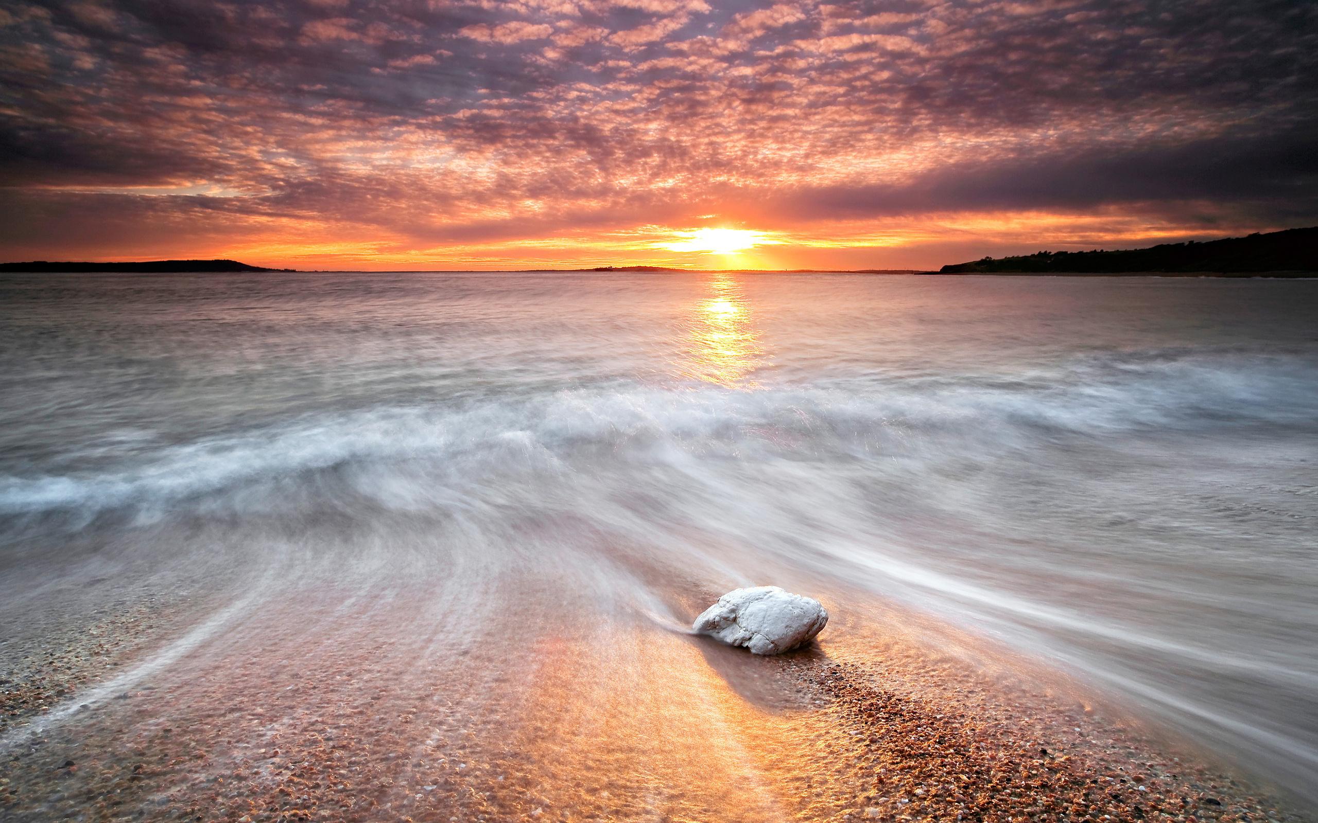Beach stone sunset