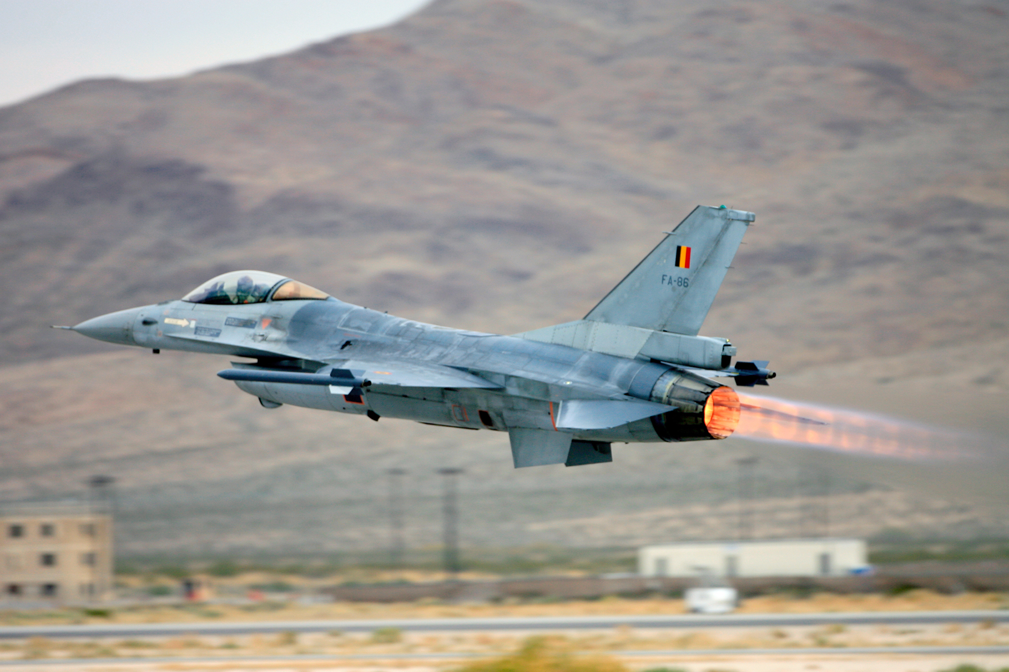 A Belgian air force F-16 Fighting Falcon takes off with full afterburning power.