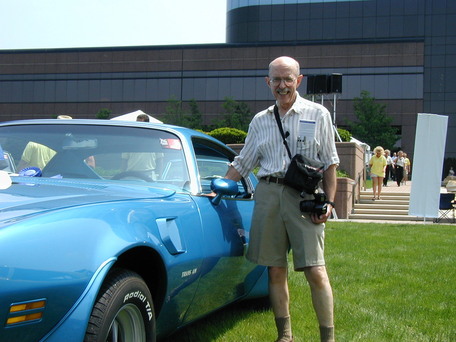 Bill Porter with the finished car at the 2002 Eyes on Design Show on the Chrysler Headquarters campus.