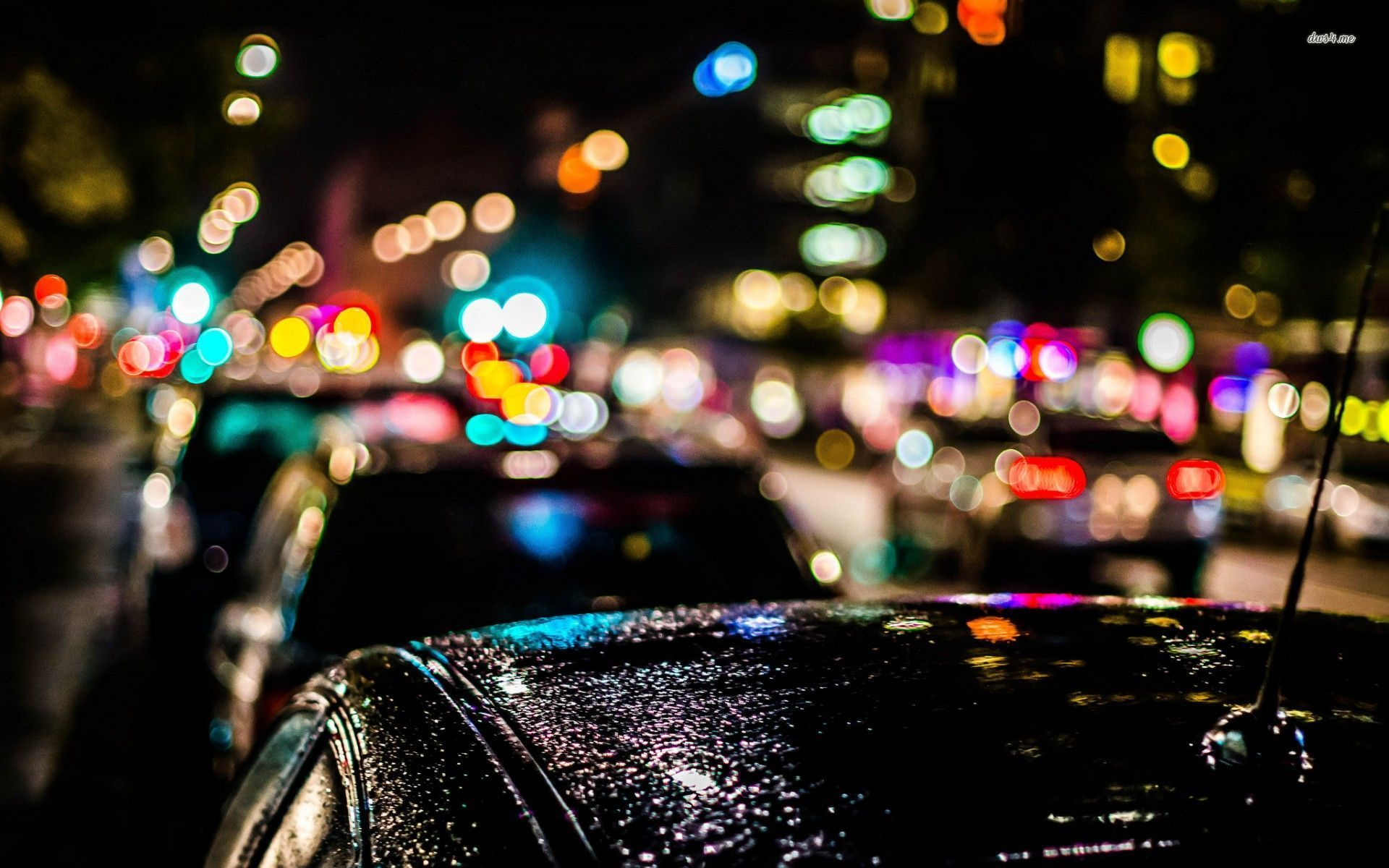 ... Blurred city lights over the cars wallpaper 1920x1200 ...