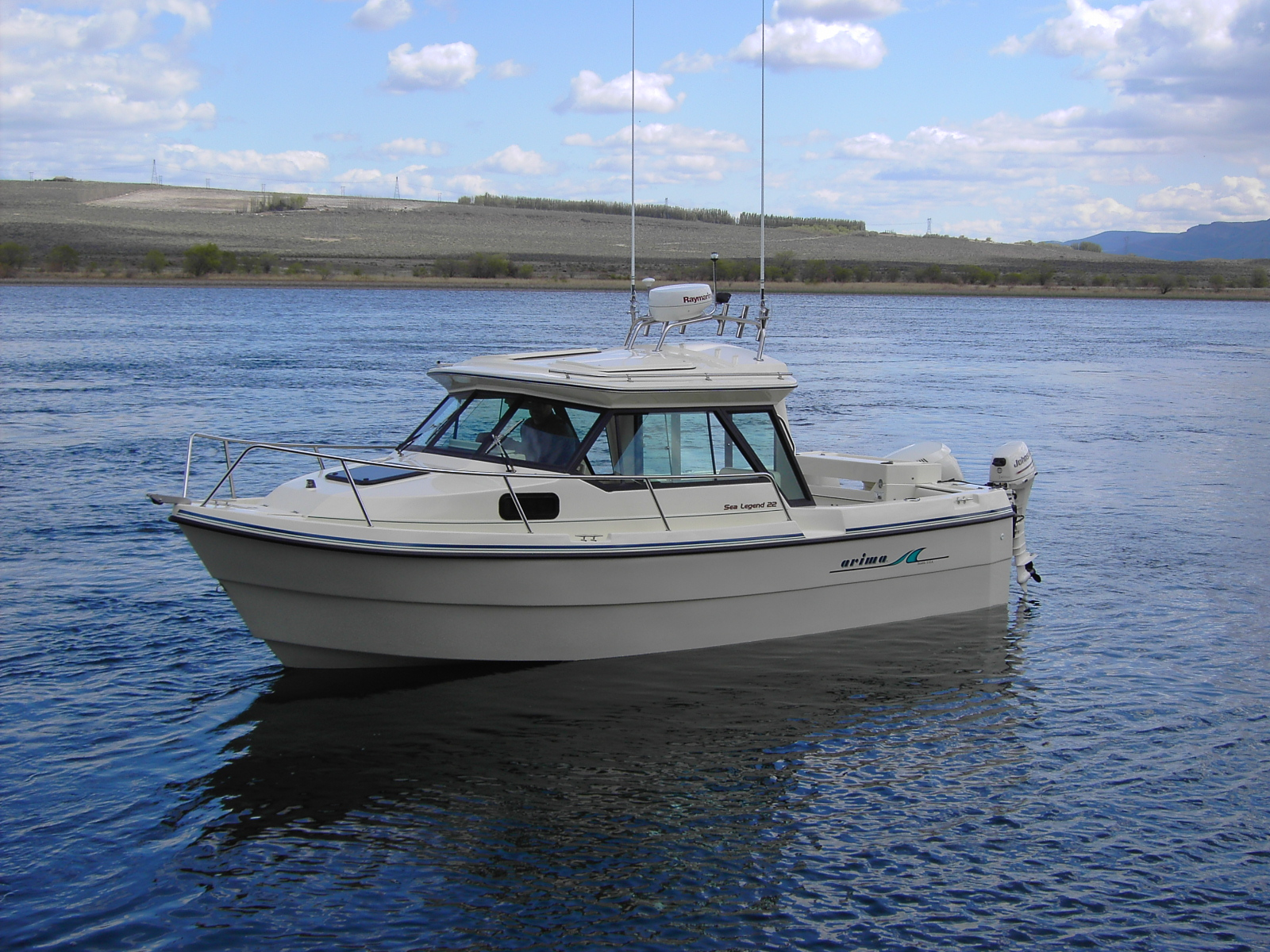 22' Arima Sea Legend Hard Top is a very open space oriented cabin boat. With the cabin construction designed to provide comfort for the fisherman and to ...