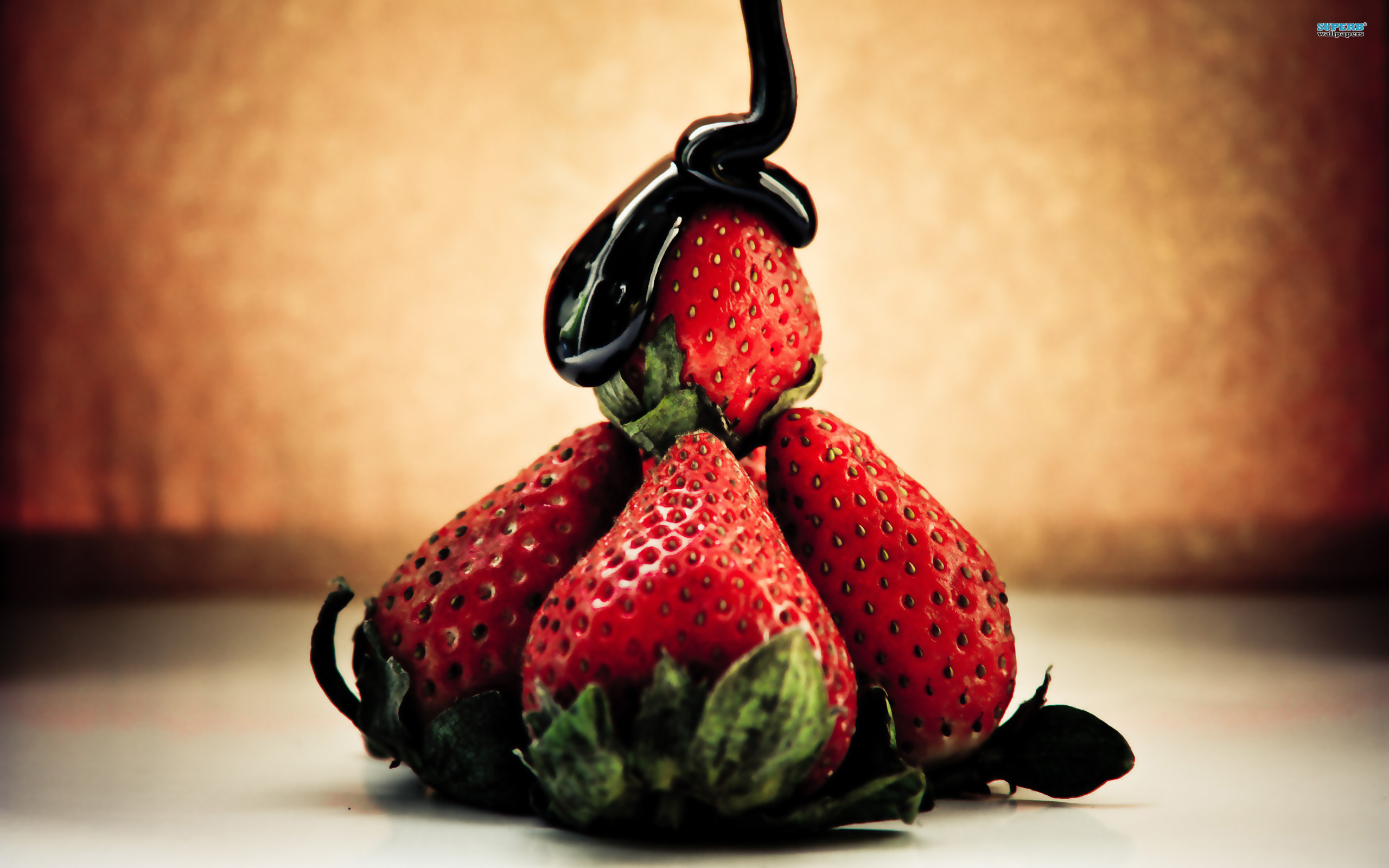 Strawberries and chocolate syrup wallpaper 2560x1600