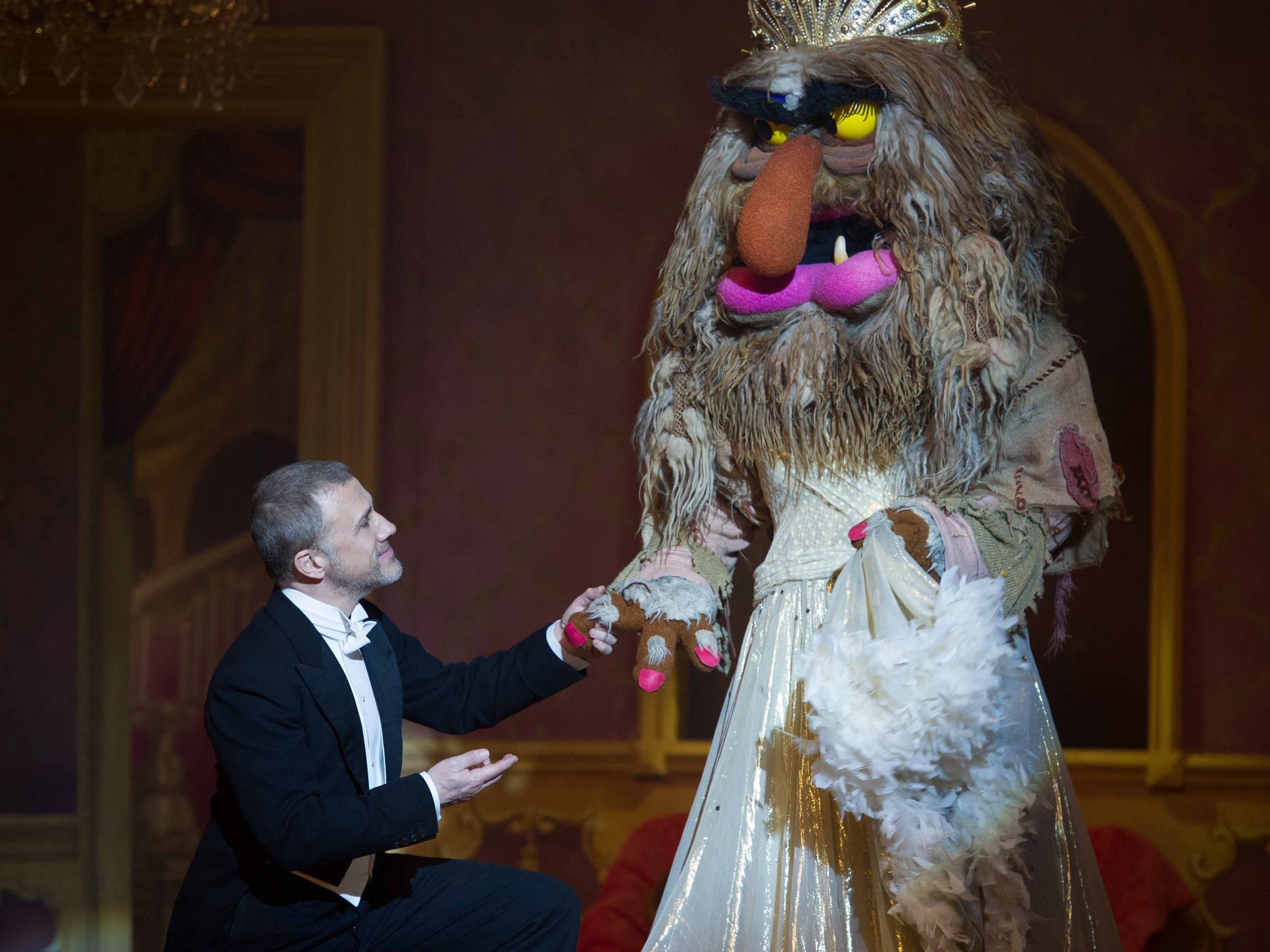 Christoph Waltz, waltzing with Sweetums in Muppets Most Wanted.