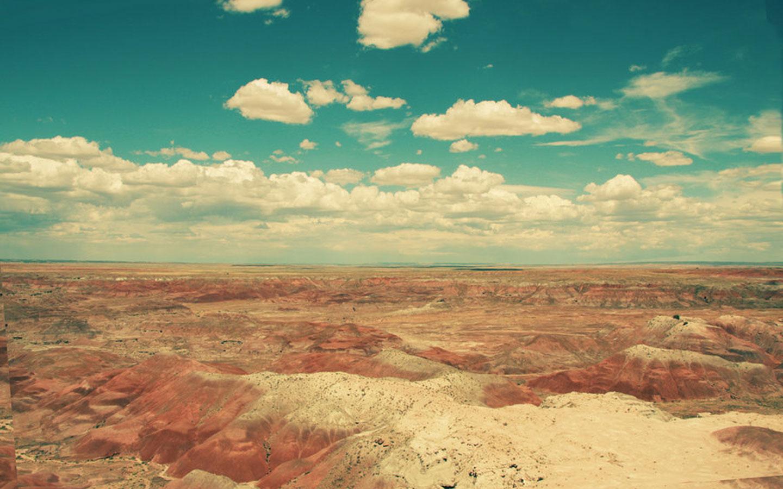 Clouds Over Rocky Desert wallpaper