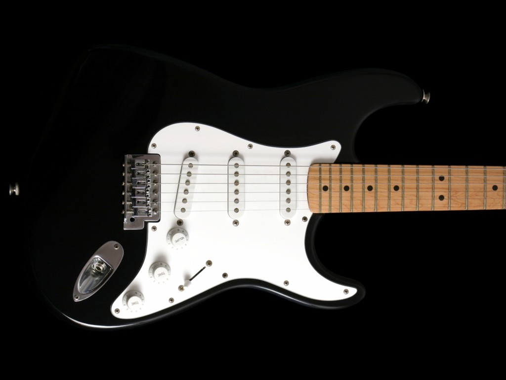 "Pluck and Play Guitar. ""Black Electric."" http://www.pluckandplayguitar.com/guitar…(accessed February 7th, 2011)."