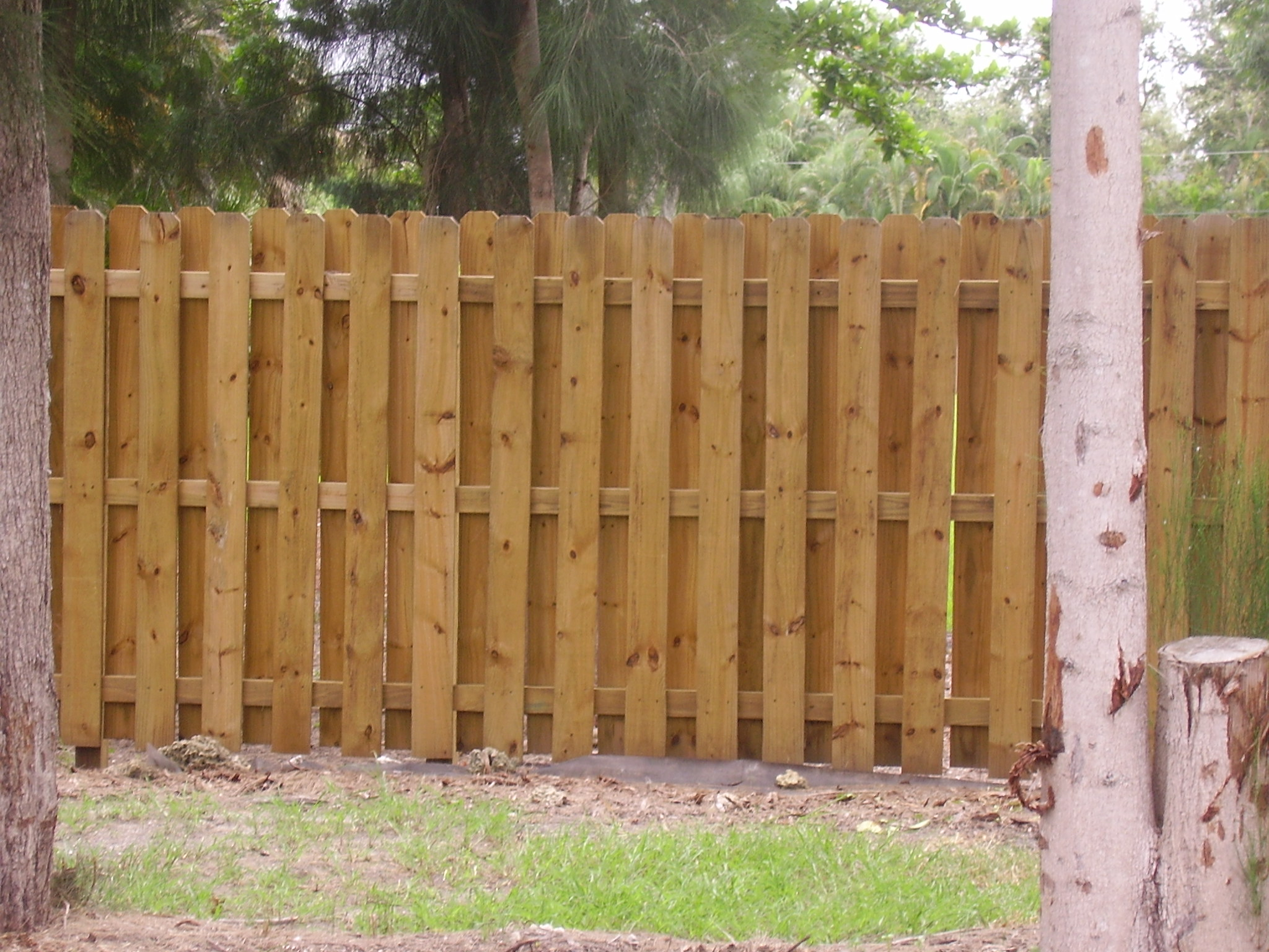 Both sides of the fence look the same. The posts are seen on the inside. This fence has diagonal visibility and allows for air to flow through the fence.
