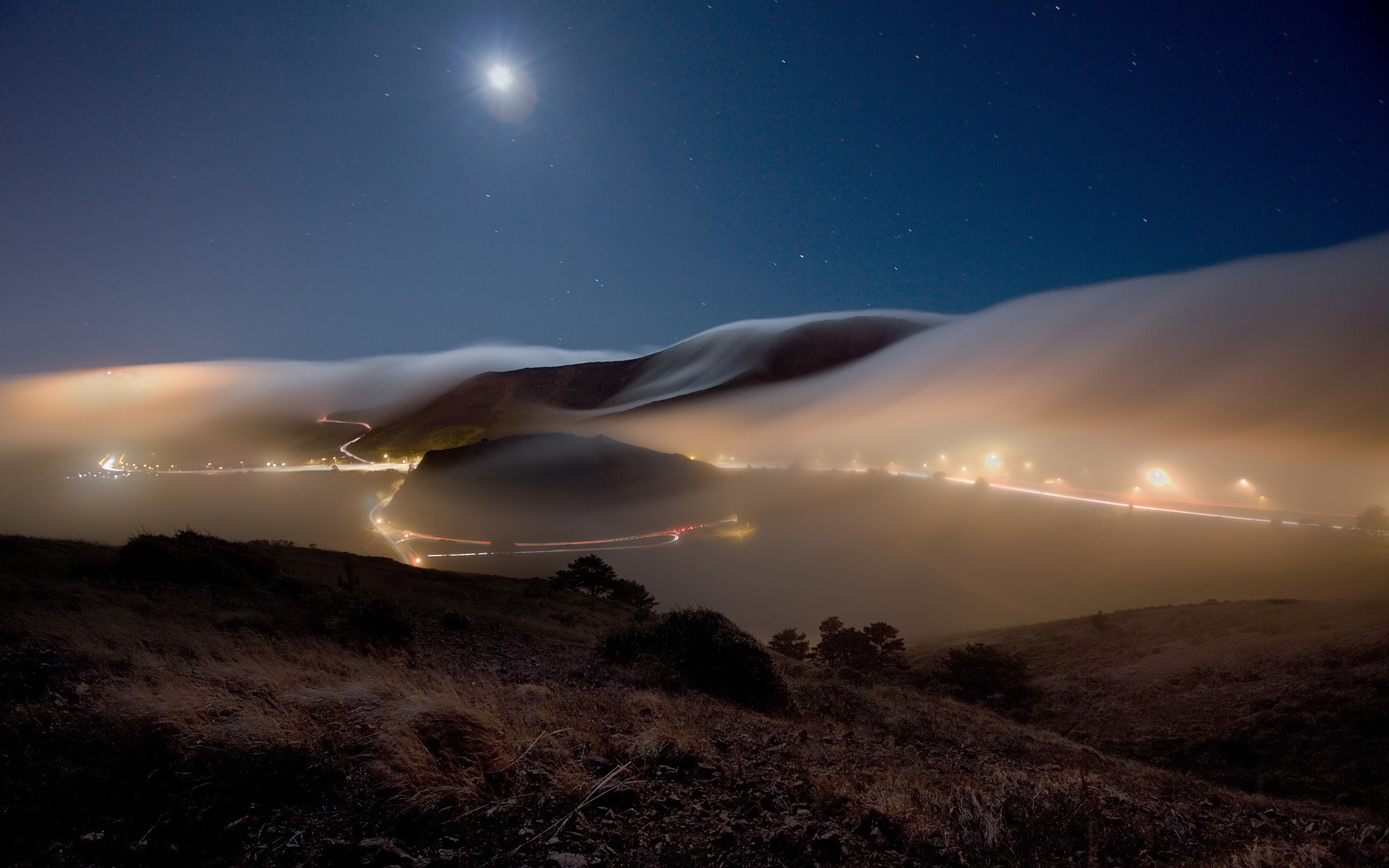 Fog over mountains night