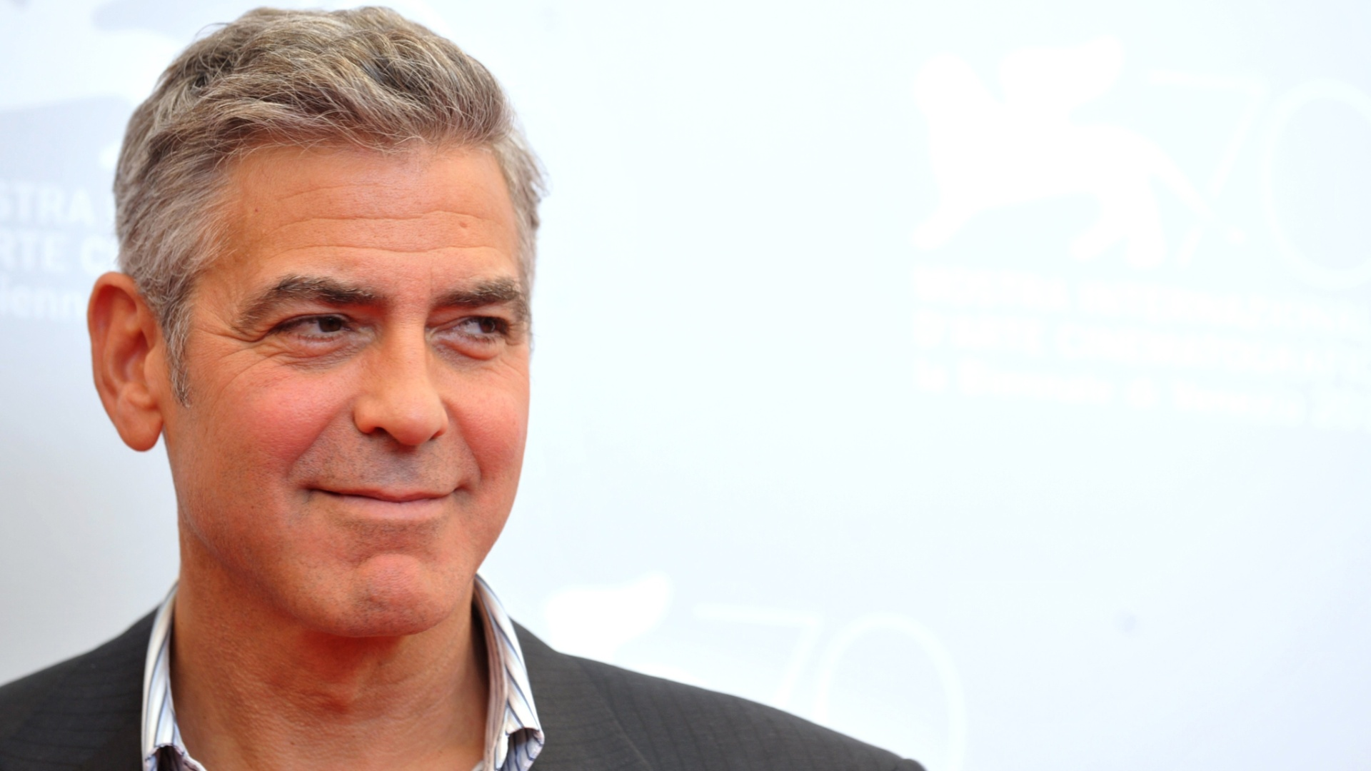 "Easy for you to say, George! Clooney urges men to embrace their age instead of ""trying to fight it"" 