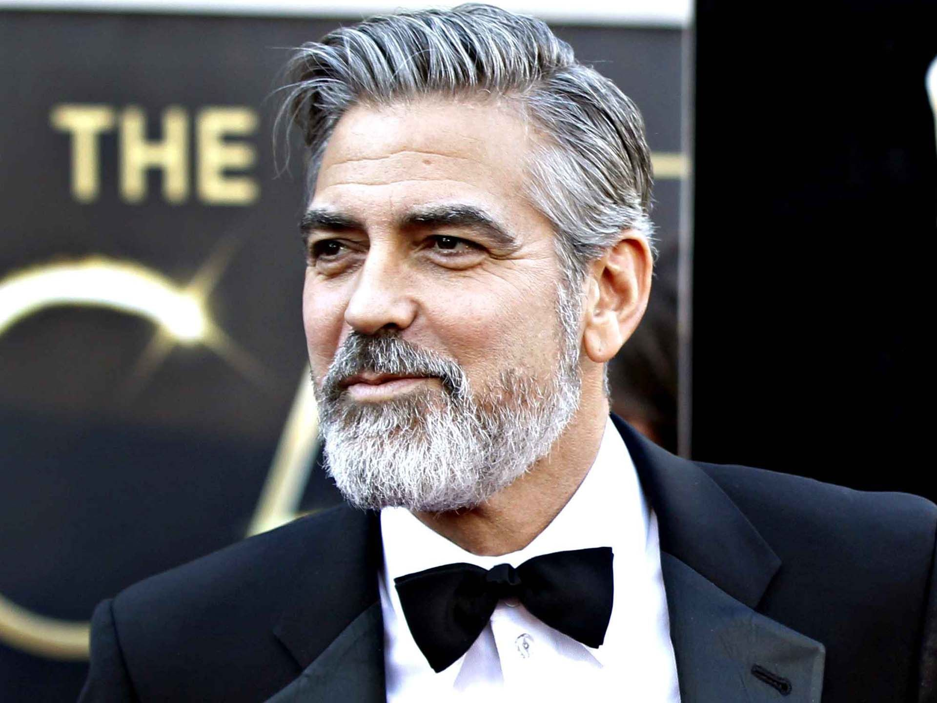 "Actor George Clooney Has Sworn Off Going Under The Knife To Achieve A More Youthful Look Because He Is Convinced Plastic Surgery Makes Men ""Look Older""."