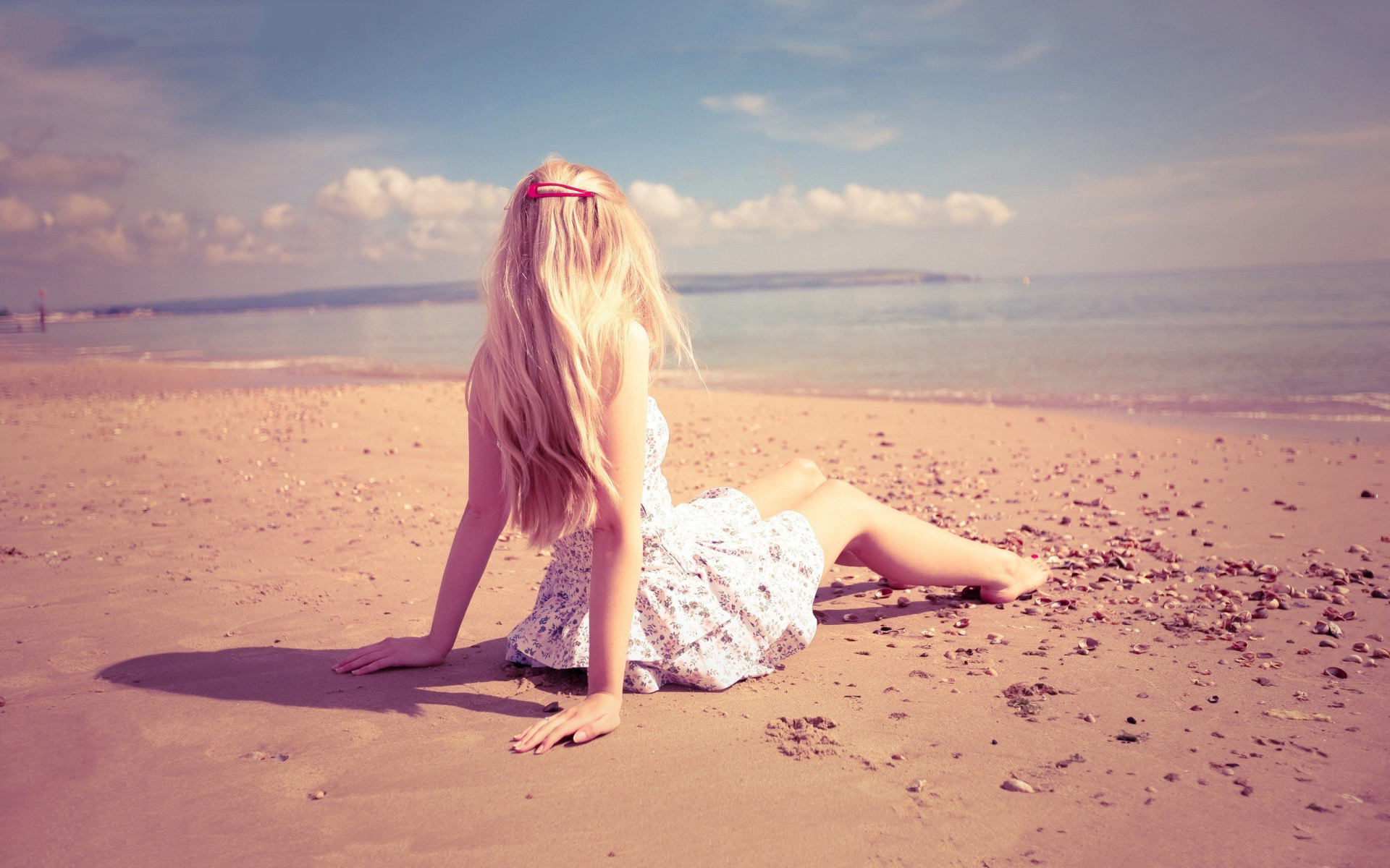Lonely girl sitting on beach