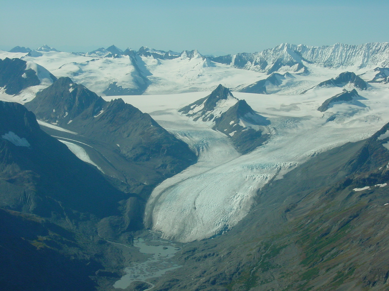 The retreating terminus of Stephens Glacier with several of its retreating unnamed valley glacier tributaries. The easternmost former tributary lost contact ...