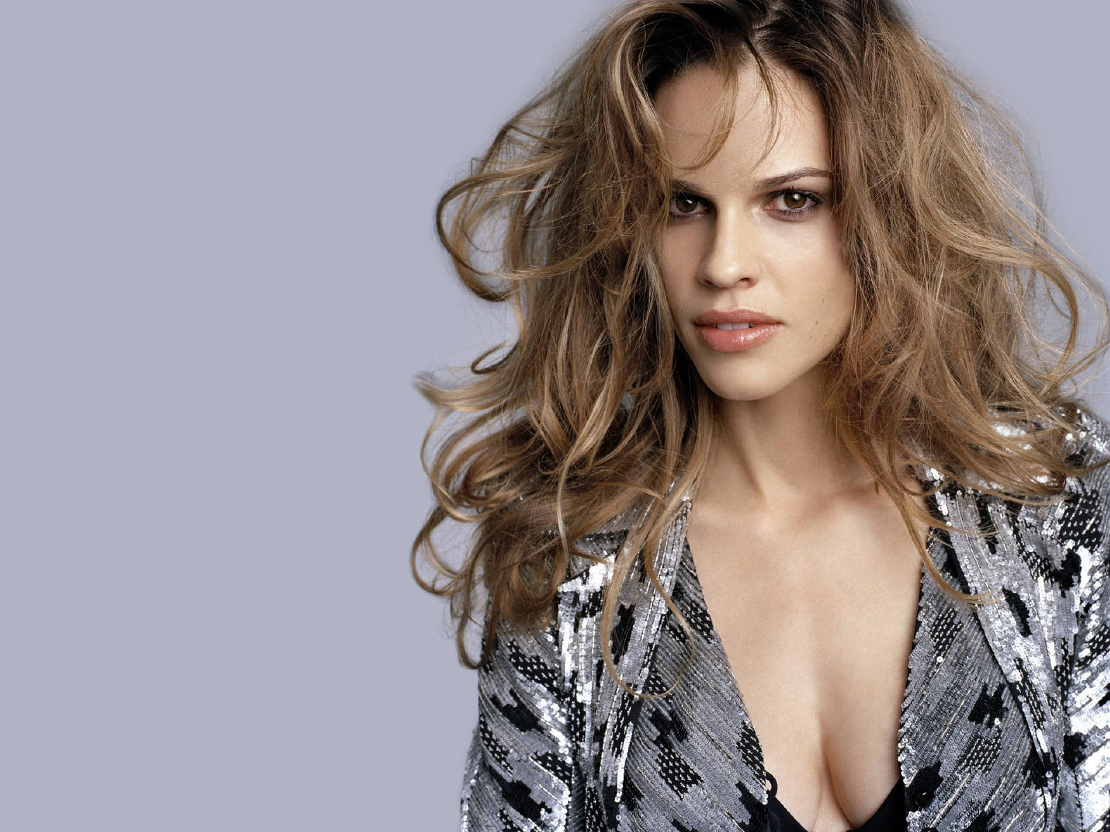 10 Famous Celebrities Who Once Lived In Their Cars - Hilary Swank - 40 million