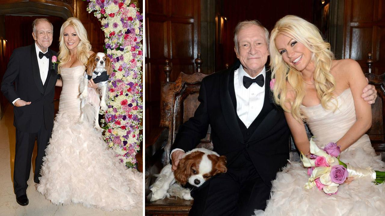 Hugh Hefner and Crystal Harris posed with their Cavalier King Charles Spaniel Charlie for an official