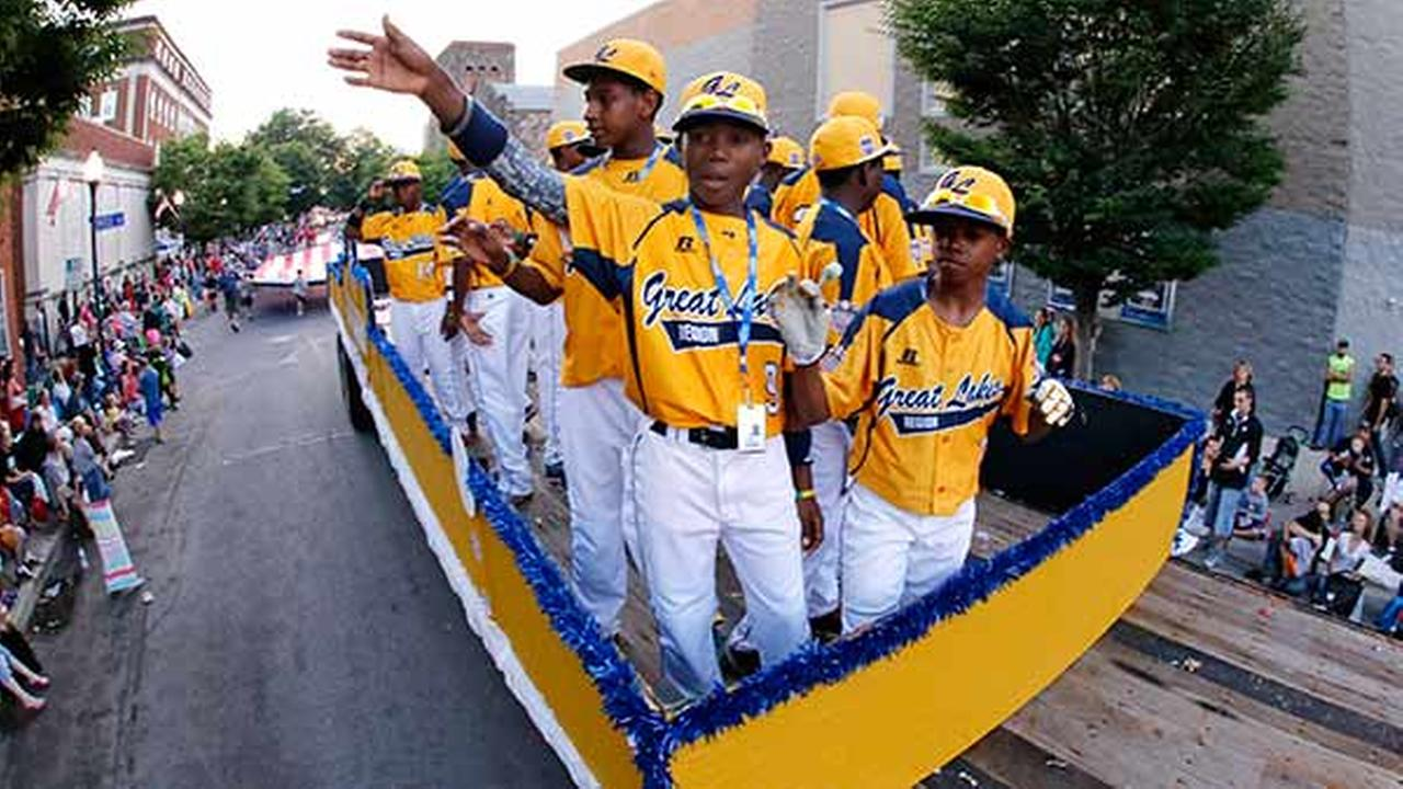 Members of the Jackie Robinson West Little League team from Chicago, Ill., ride
