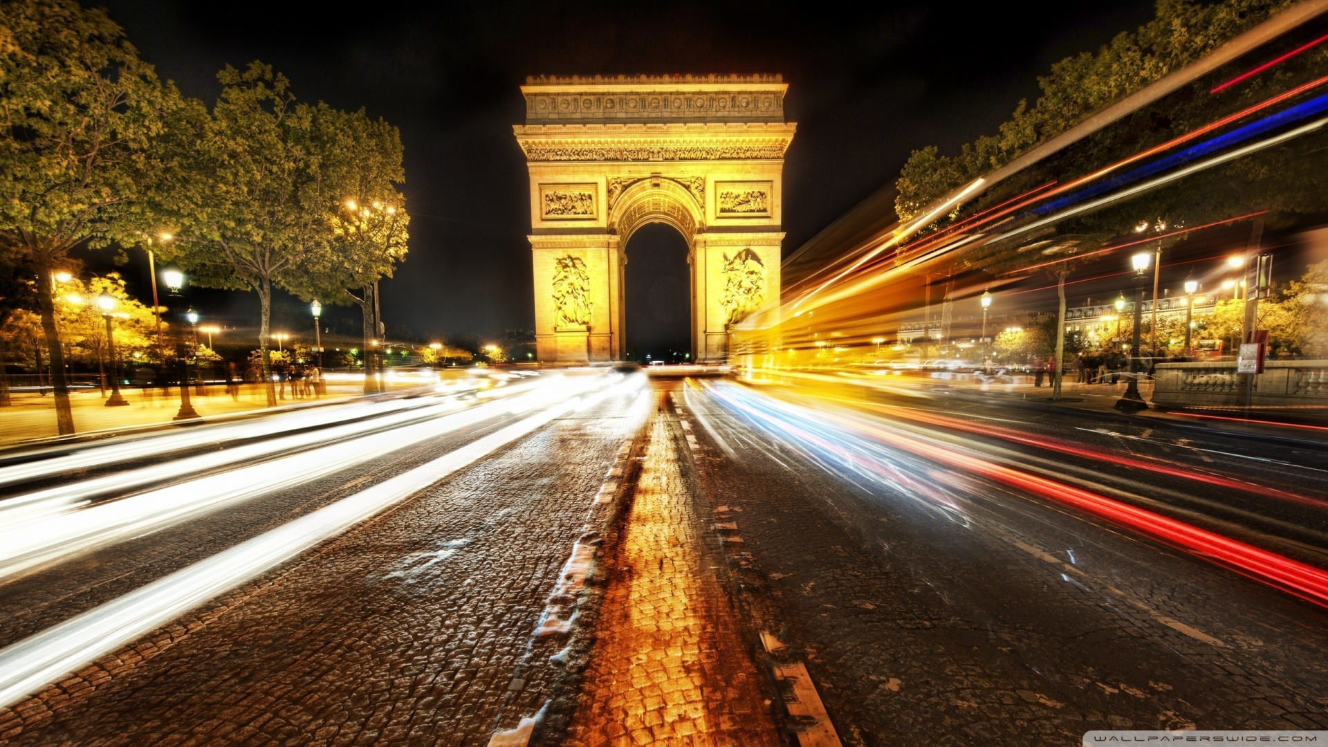 ... arc-de-triomphe-at-night-long-exposure-road-