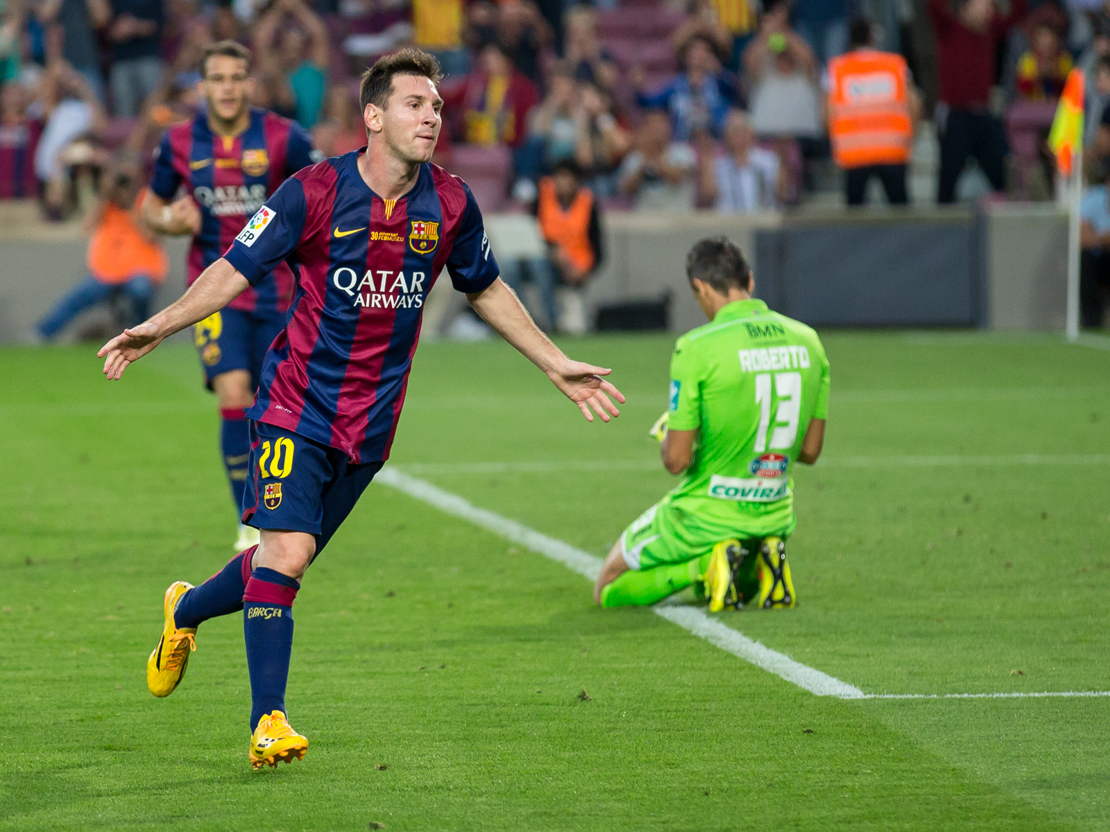 Messi celebrating scoring a goal against Granada CF in October 2014.