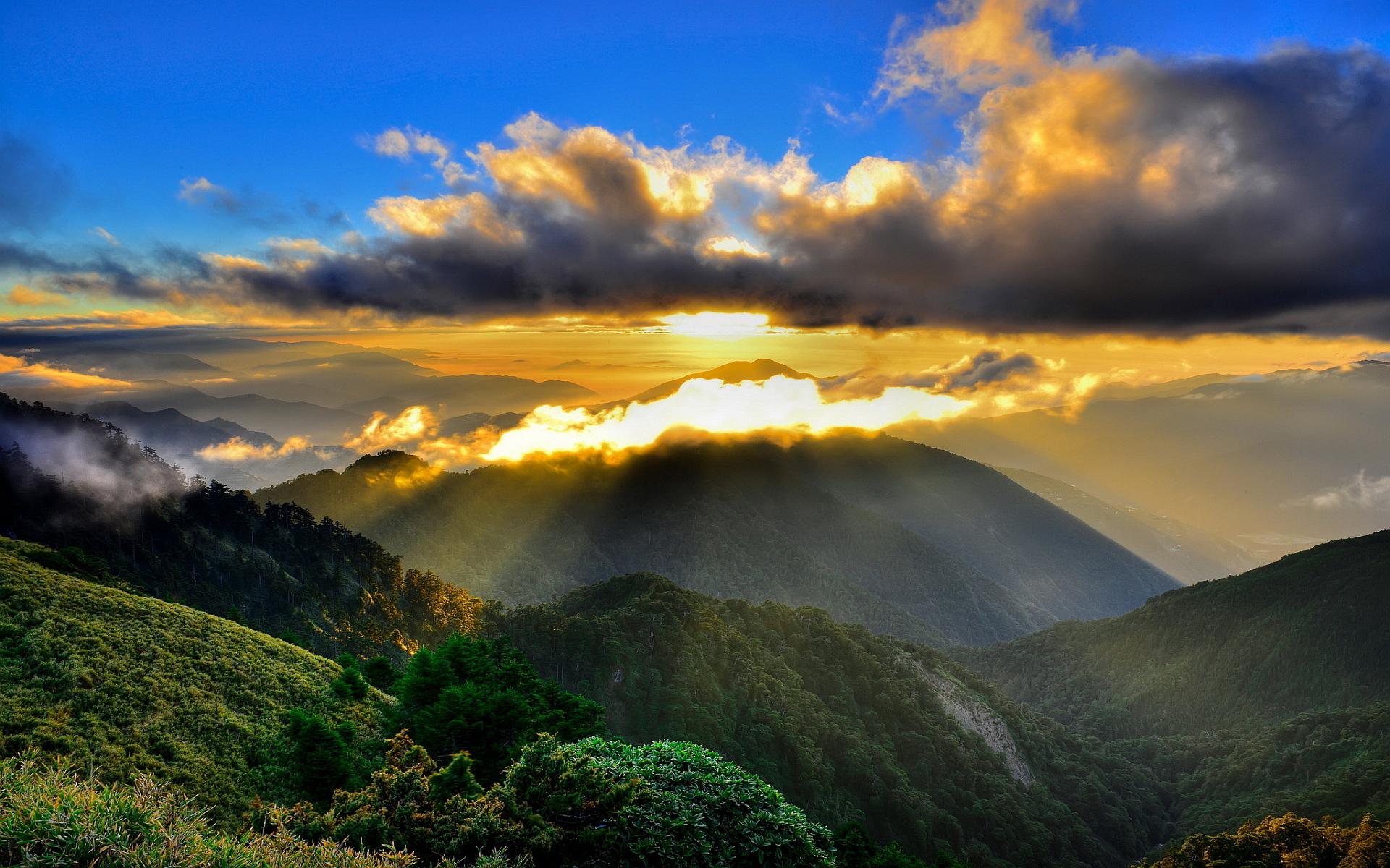 Mountains clouds sundown
