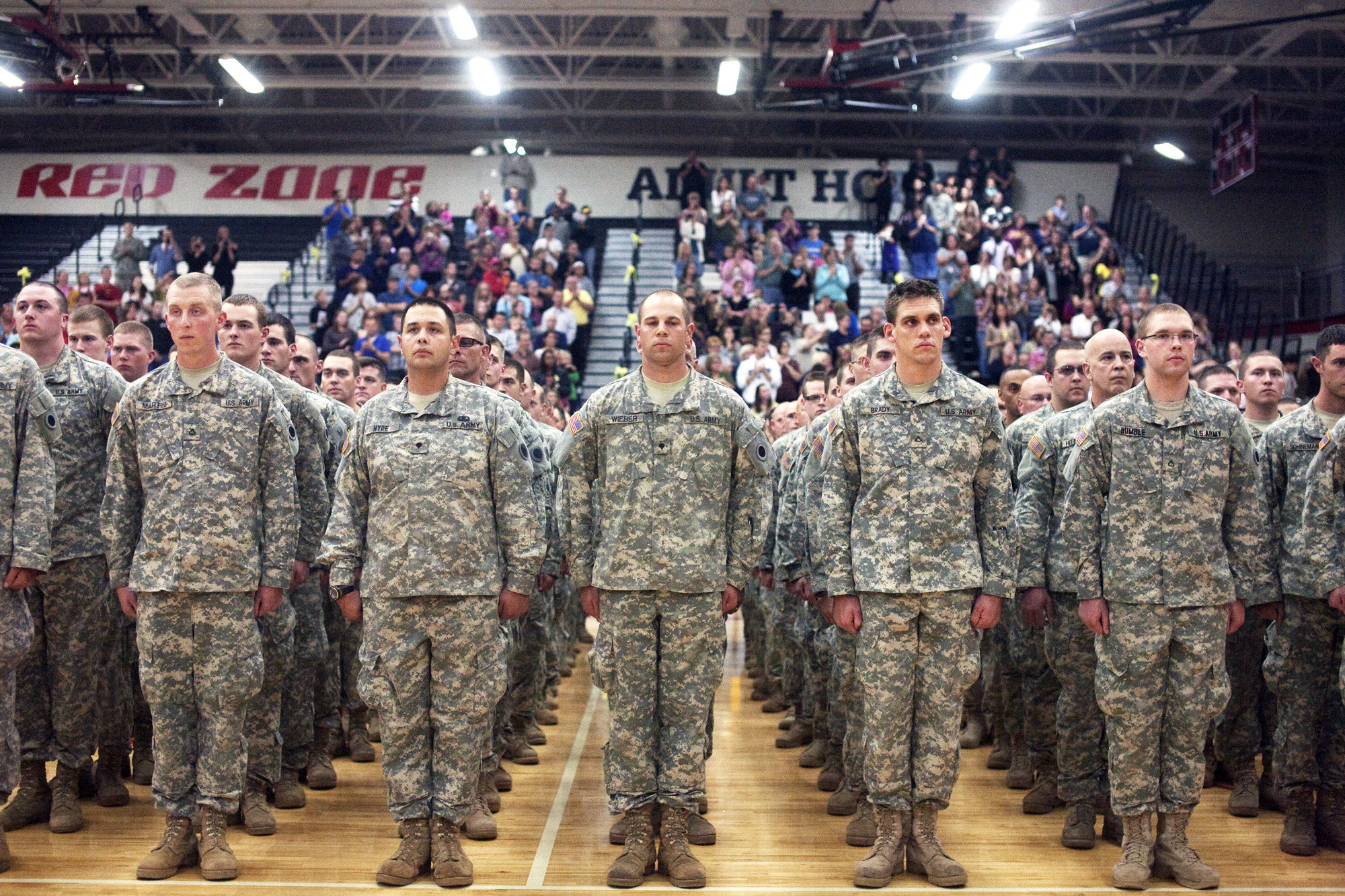 ... 125th National Guard Infantry Regiment stand before friends and family during a departure ceremony at Grand Blanc High School on Monday night.