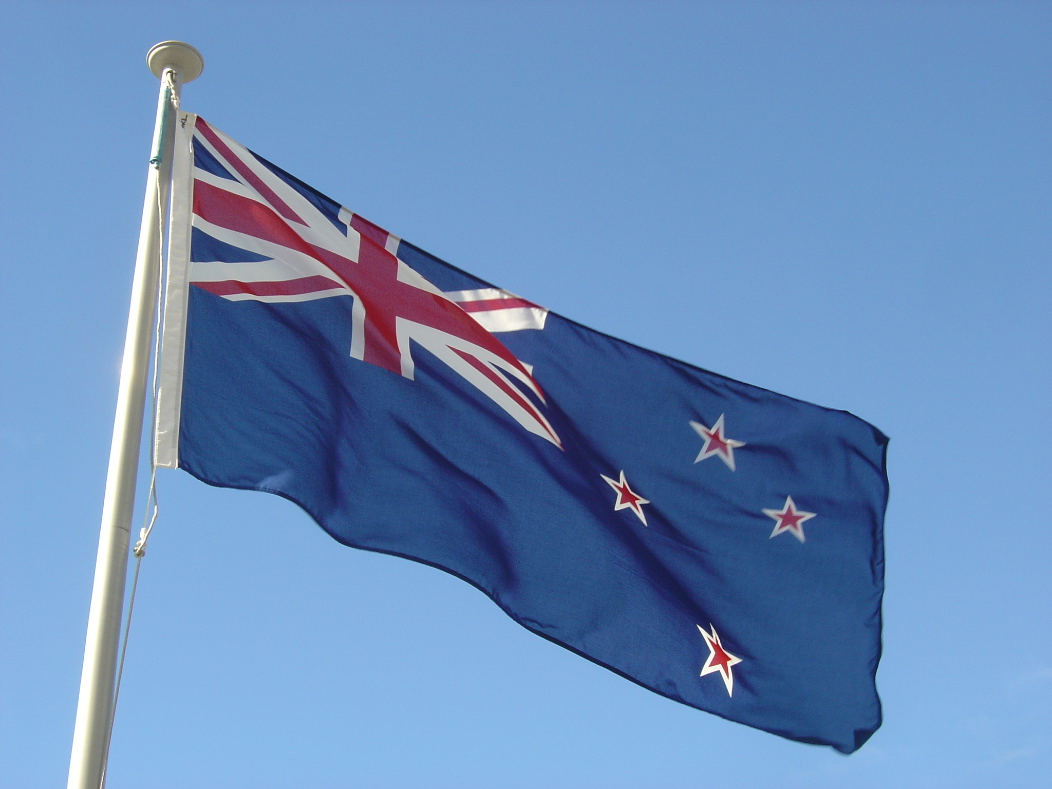 The flag of New Zealand outside the Beehive in Wellington.