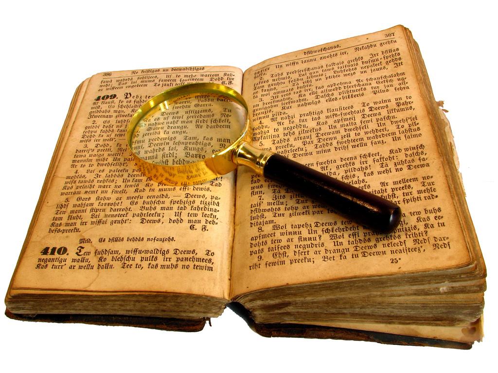 ... an old book with a looking glass | by ēst smiltis no ausīm