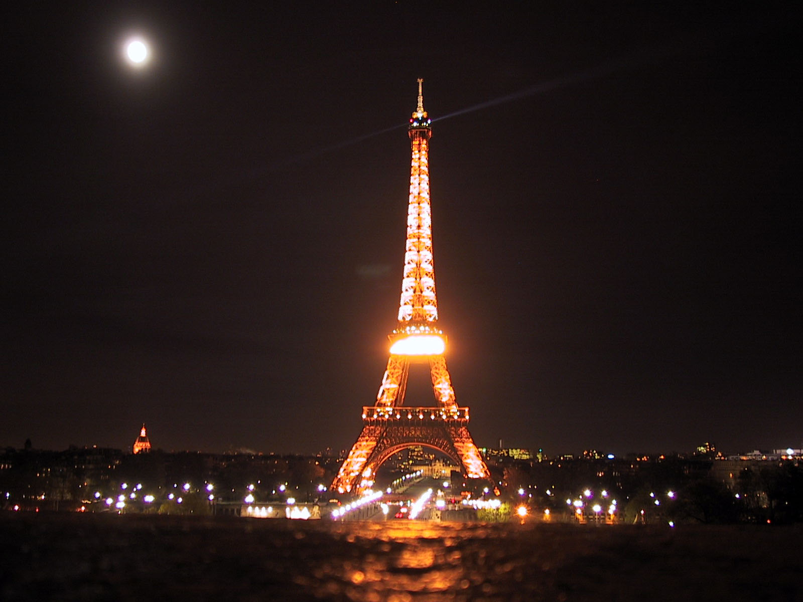 Eiffel tower lights, under moonlight, paris