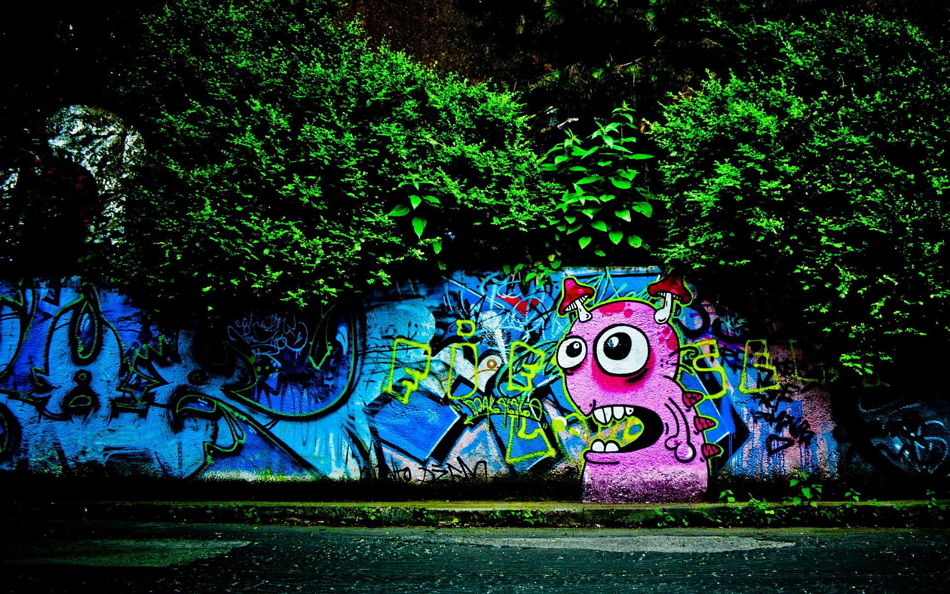 Pink graffiti monster on wall