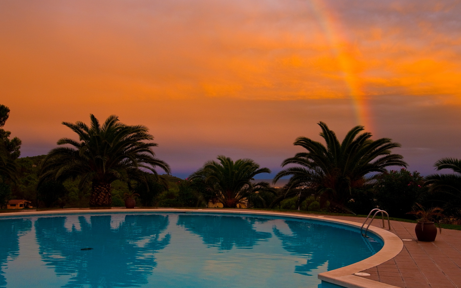 Pool rainbow sunset
