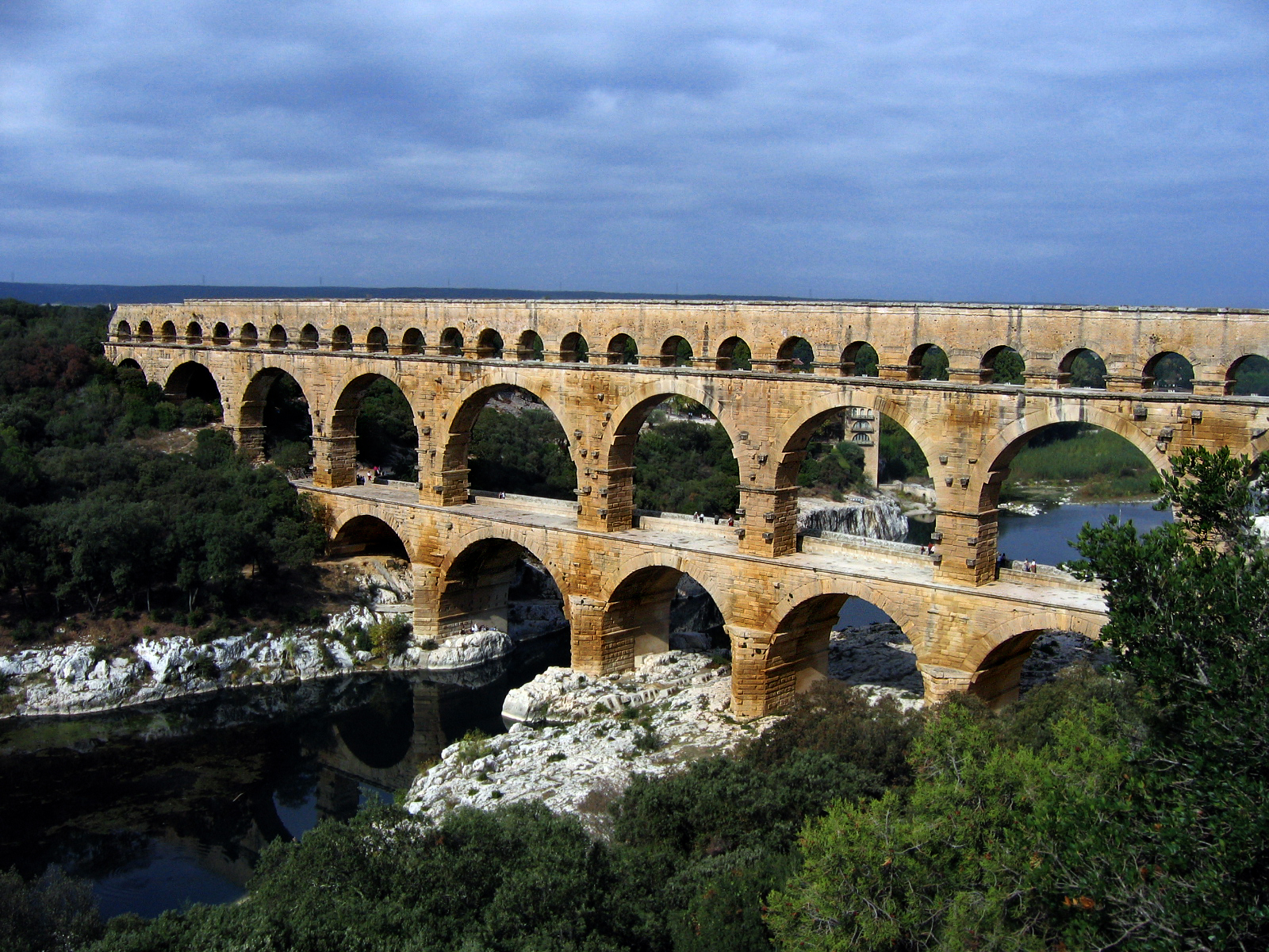 The multiple arches of the Pont du Gard in Roman Gaul (modern-day southern France). The upper tier encloses an aqueduct that carried water to Nimes in Roman ...