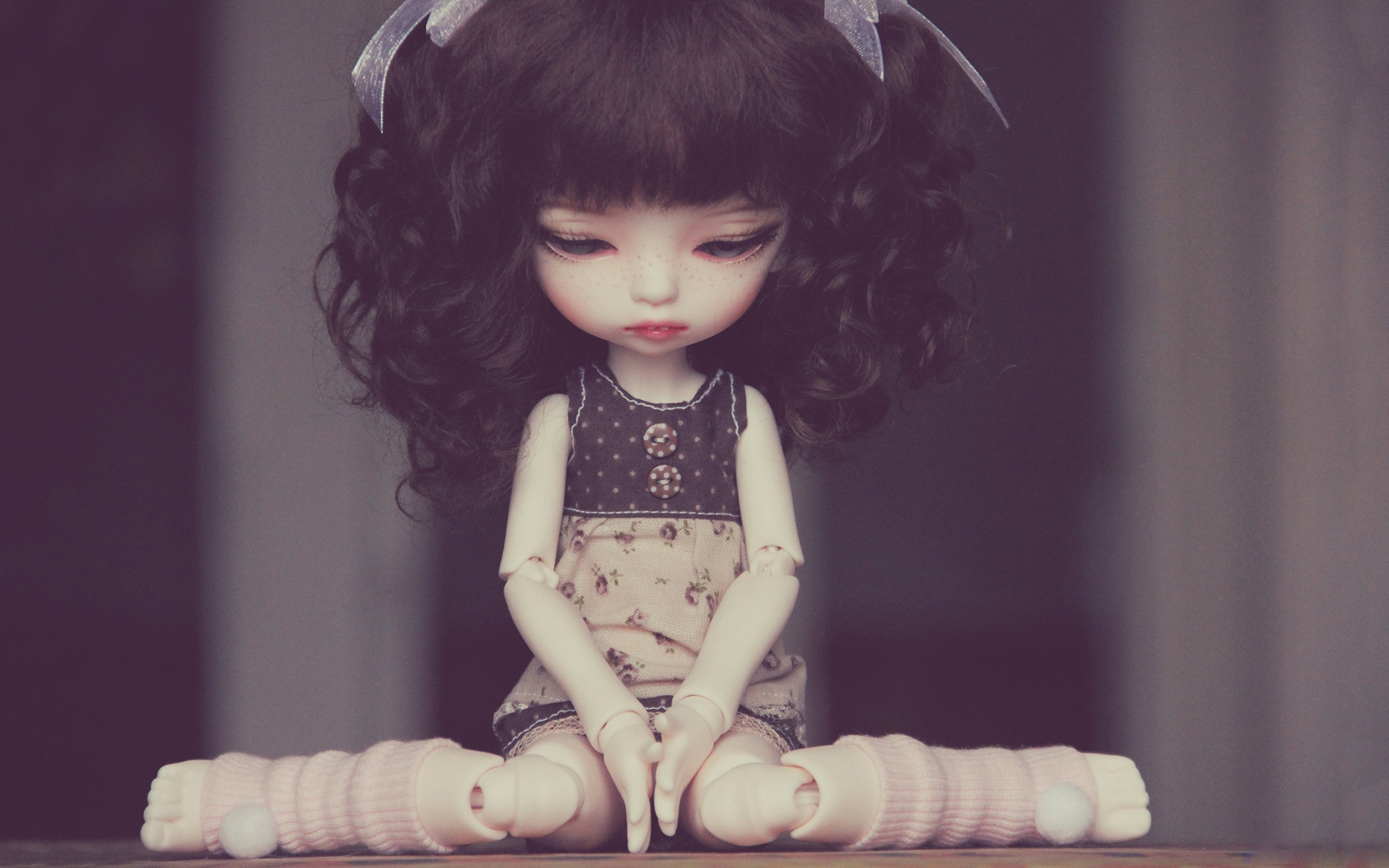 Sad doll sitting