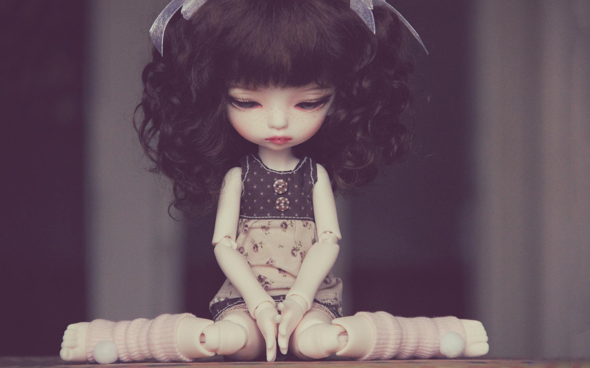 Sad doll sitting