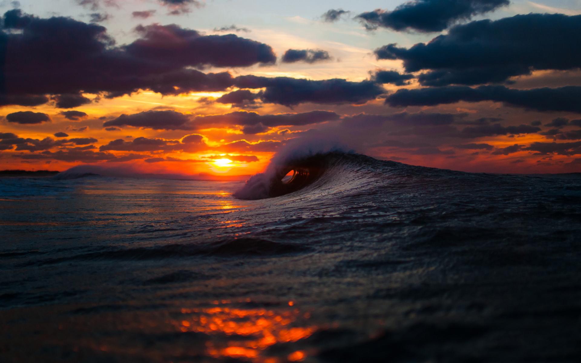 Sea wave sunset