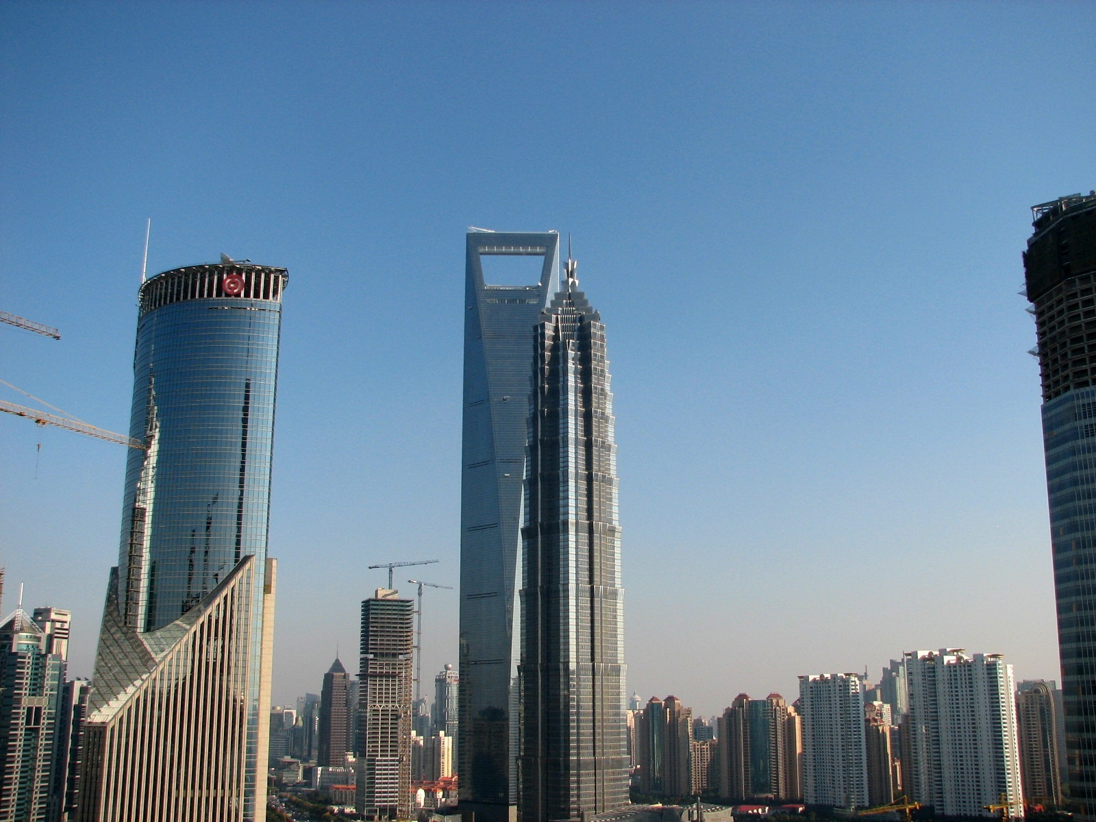 "Free Shanghai City pictures: Pudong Center with its mushrooming skyscrapers. The ""window"" shaped building - 101-story World Financial Center for few years ..."