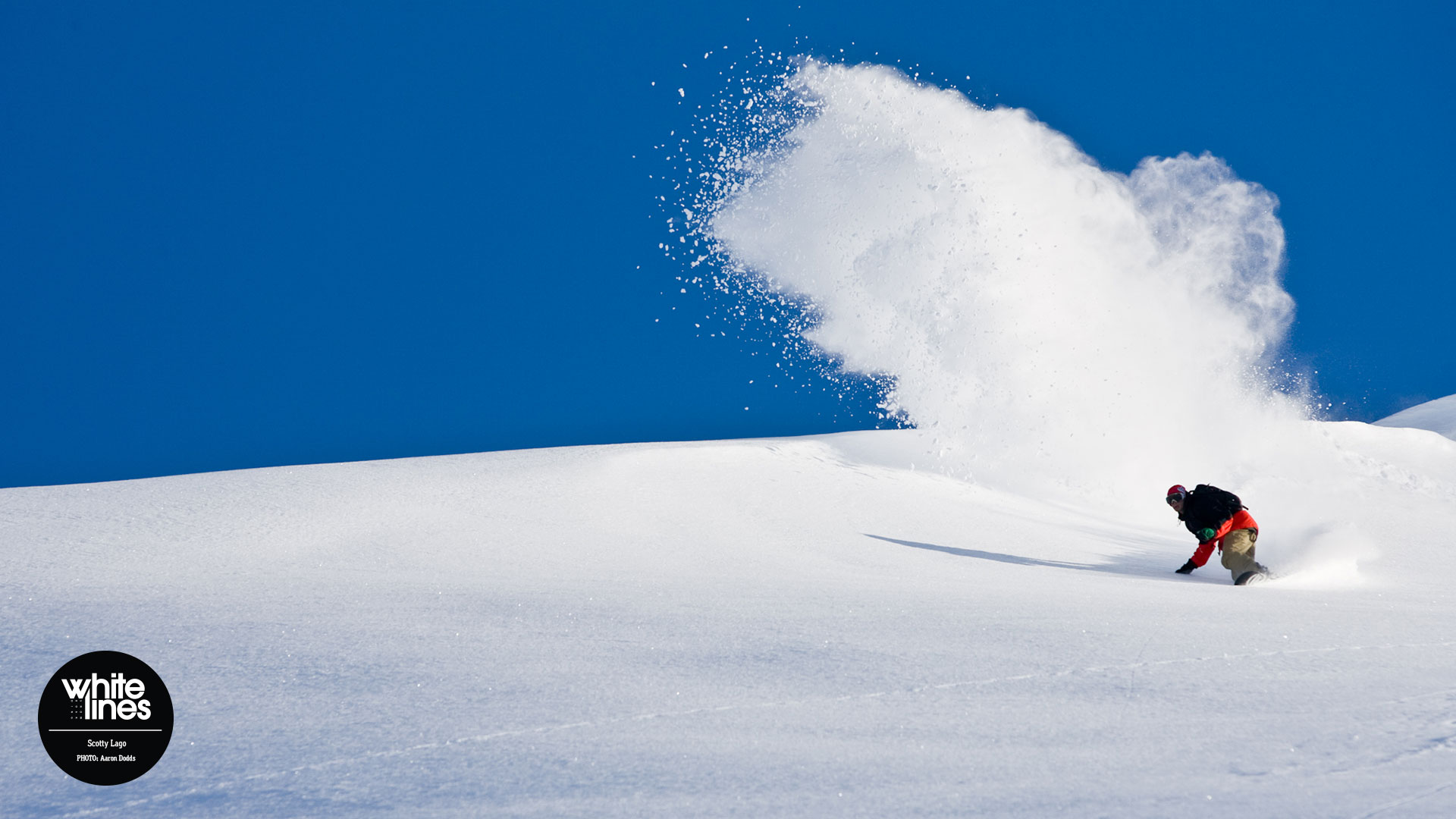 Snowboard Wallpaper - Scotty Lago kicks up a rooster tail in Alaska