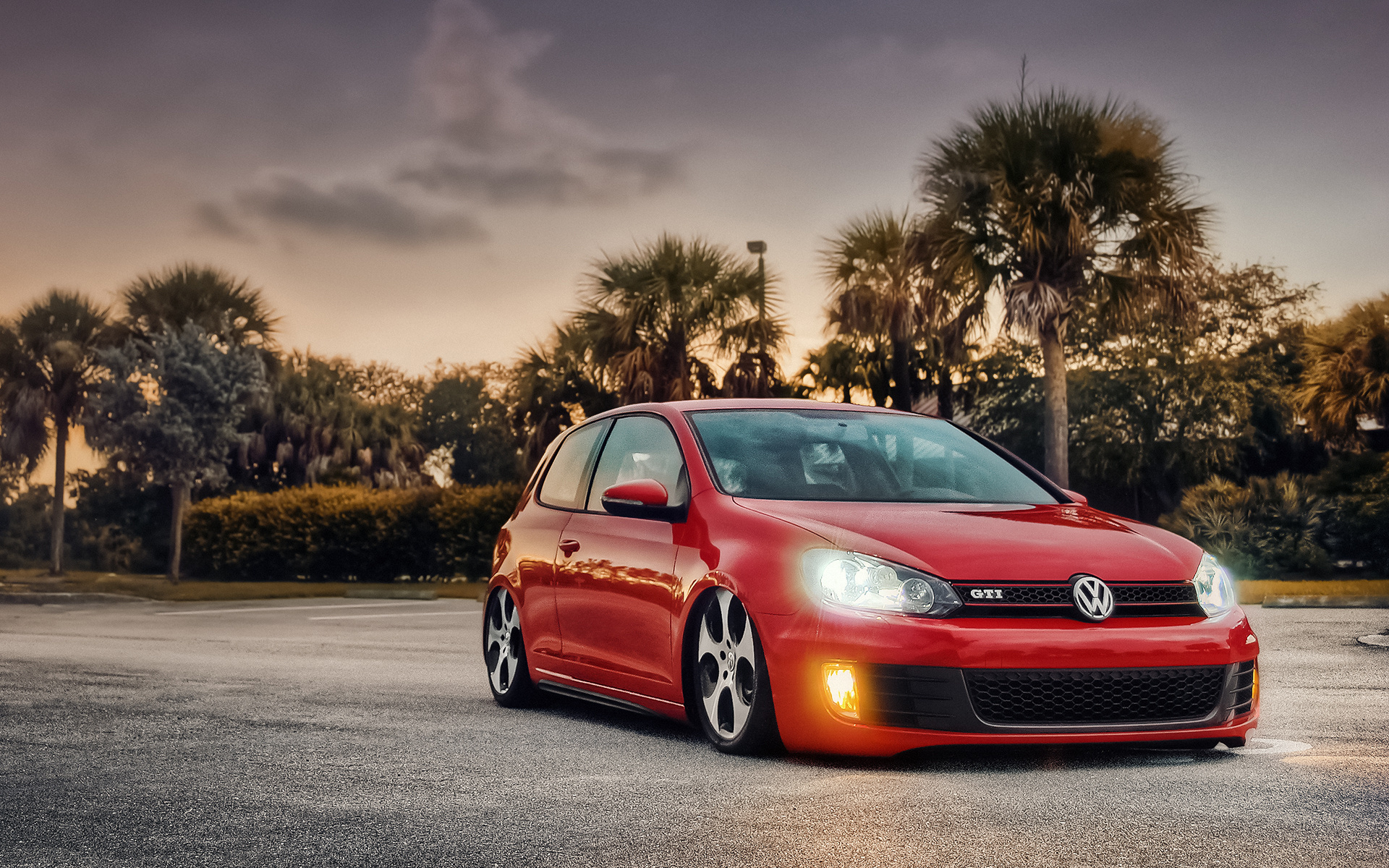 "Download the following Stunning Red Volkswagen GTI Wallpaper 42975 by clicking the orange button positioned underneath the ""Download Wallpaper"" section."