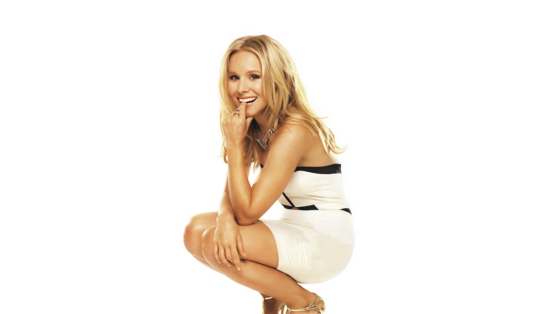 "Download the following Stunning Kristen Bell 23608 by clicking the orange button positioned underneath the ""Download Wallpaper"" section."