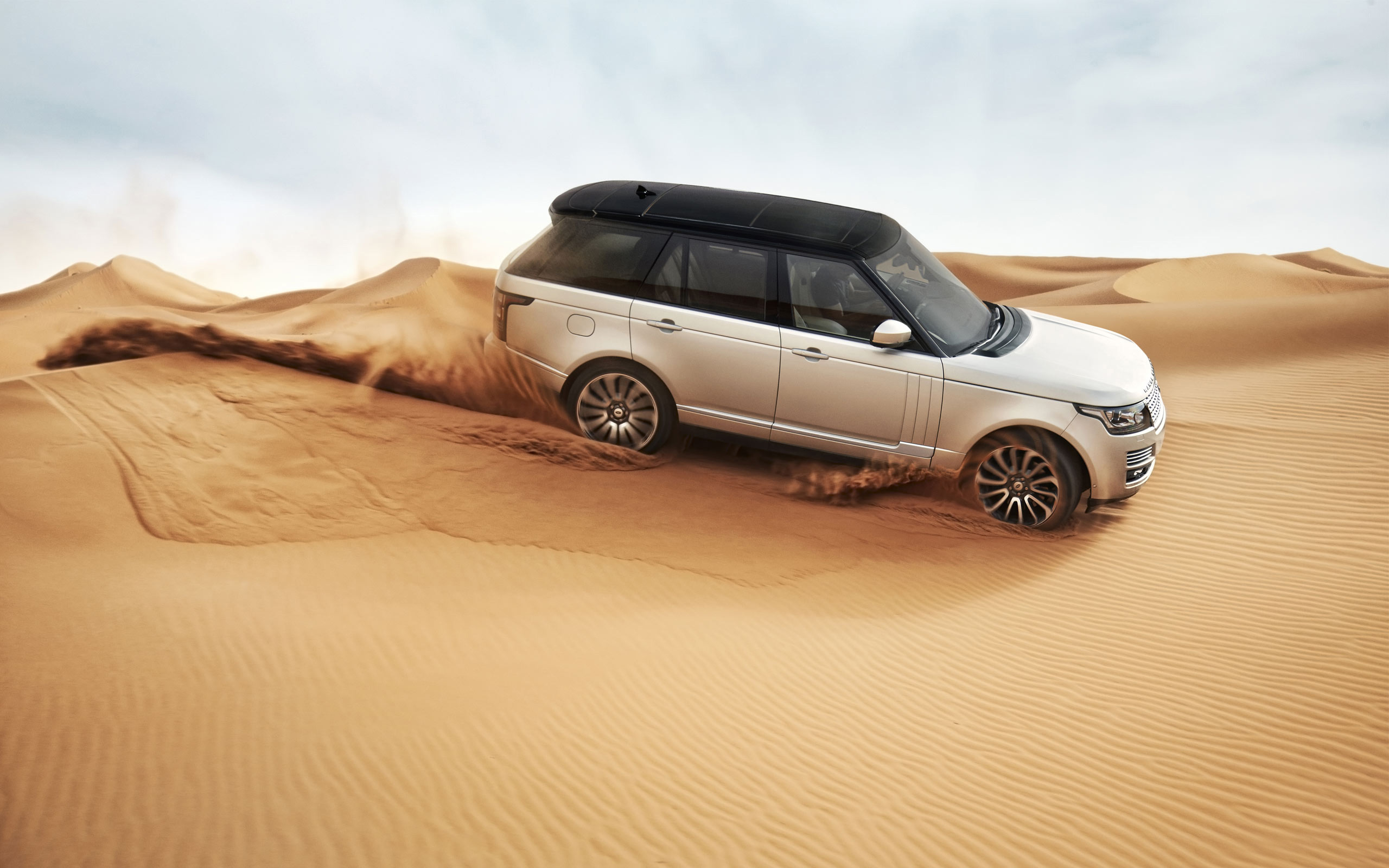 "Download the following Stunning Range Rover Wallpaper 29133 by clicking the orange button positioned underneath the ""Download Wallpaper"" section."