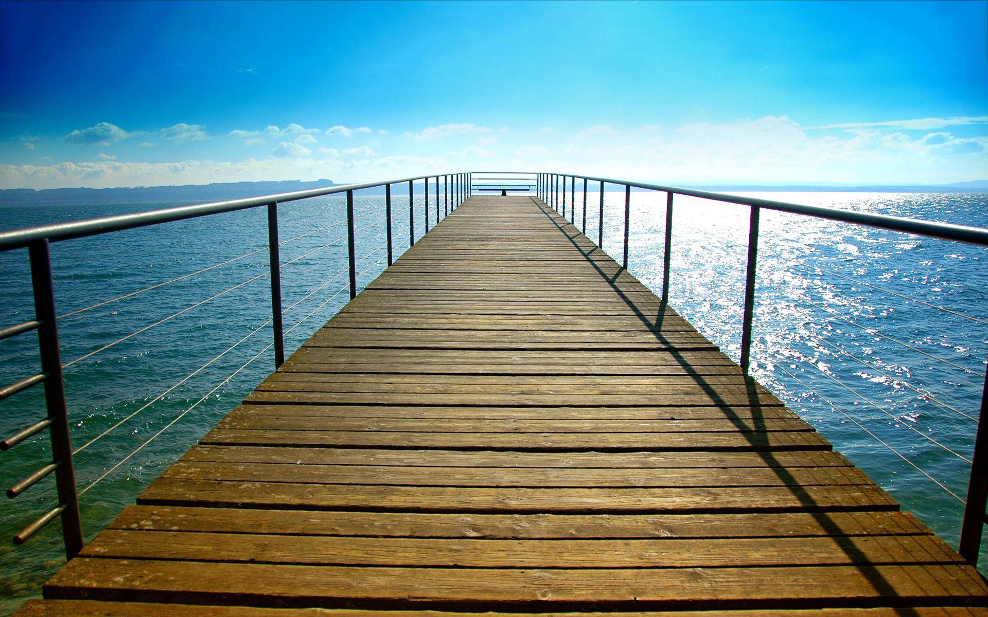 Sunny day lake bridge