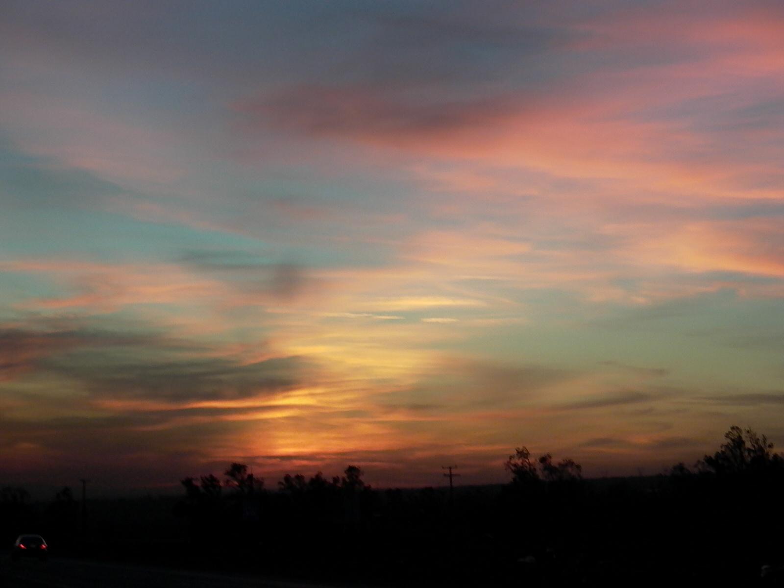 (Light): sunset clouds pink yellow blue sky MY.jpg. D=2003-04-14 [Apr 14, 2003]; S=414kB, 1600x1200; T=JPEG image [MIME:image/jpeg].