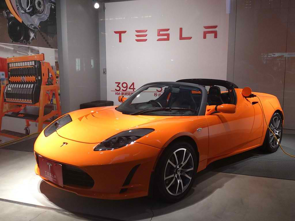 A Tesla Roadster on public display at a Japan-based showroom. It is also being charged.