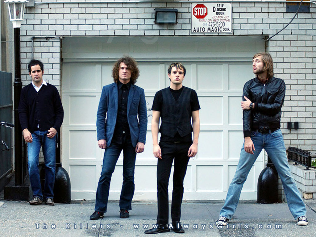 The Killers The Killers... Standing in front of a garage.