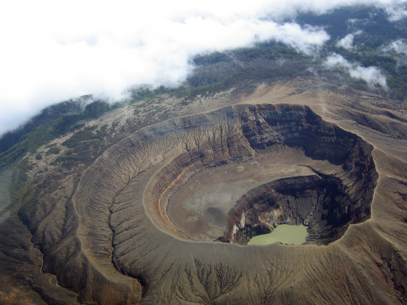 Santa Ana Volcano, El Salvador, a close up aerial view of the nested summit calderas and craters, along with the crater lake as seen from a United States ...