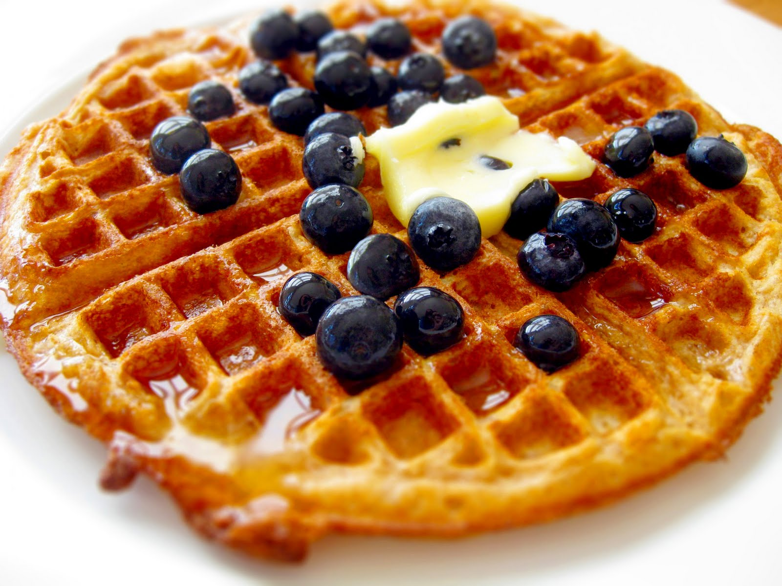 Epic closeup of a waffle with blueberries.