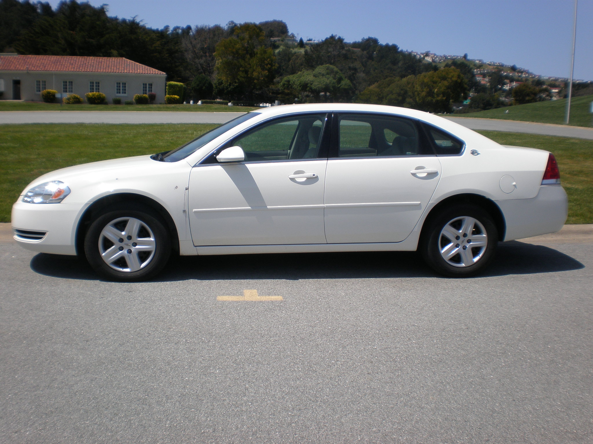 File:White Chevrolet Impala LS side.JPG
