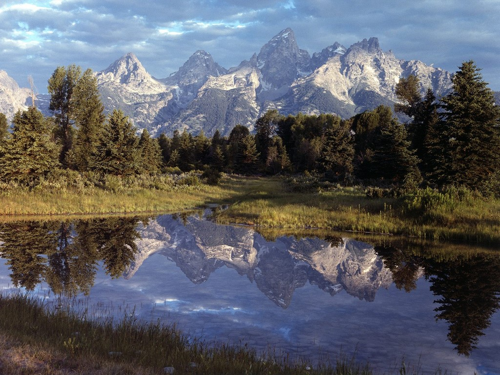 The amazingly beautiful Grand Teton reflecting in a lake that is close to where there has