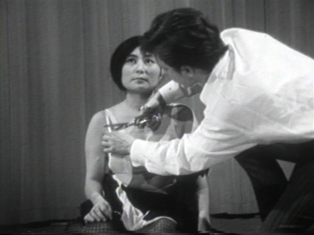 Yoko Ono performing Cut Piece, 1964