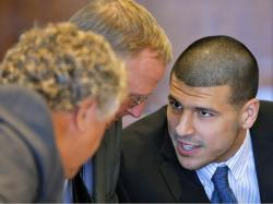 Aaron Hernandez, formerly of the New England Patriots, talks to defense attorneys Michael Fee, left, and Charles Rankin during a court appearance in Fall ...