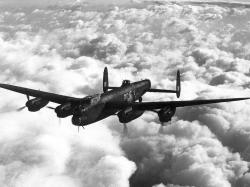 An inflight image of a four-engined bomber aircraft · Avro Lancaster ...