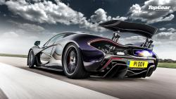 Awesome purple McLaren P1 rear side view shooting flames on the track - image via top